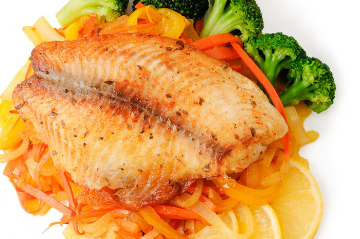 Juicy flounder with vegetables, prepared in the oven
