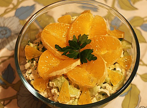 Fresh cocktail – salad with orange