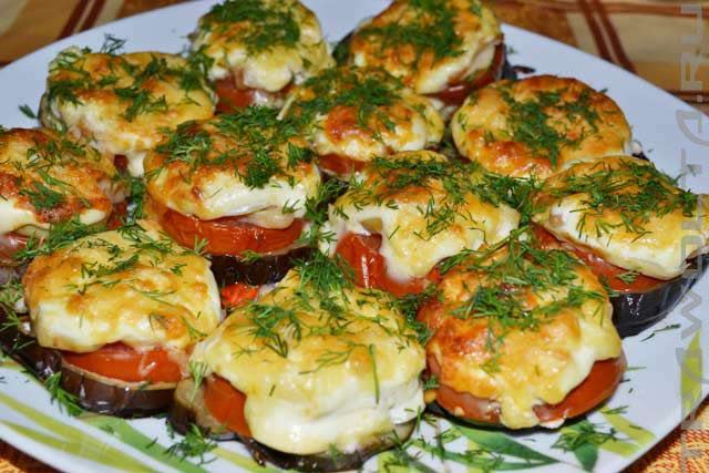 Baked eggplants with minced meat under tomato sauce