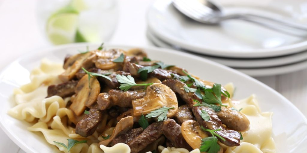 Excellent beef stroganoff with pickled cucumbers and mushrooms