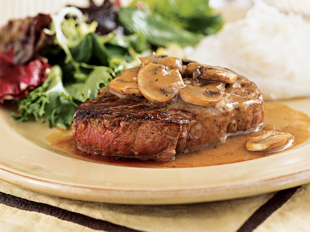Appetizing steaks with egg-wine sauce