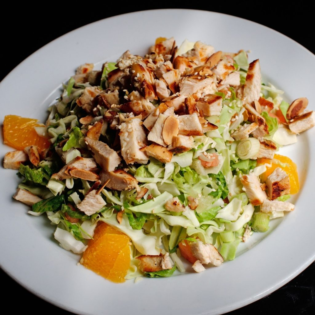 Asian salad with chicken and sesame seeds