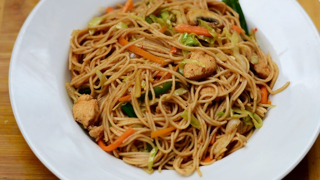 Noodles with chicken and mushrooms in Asian style