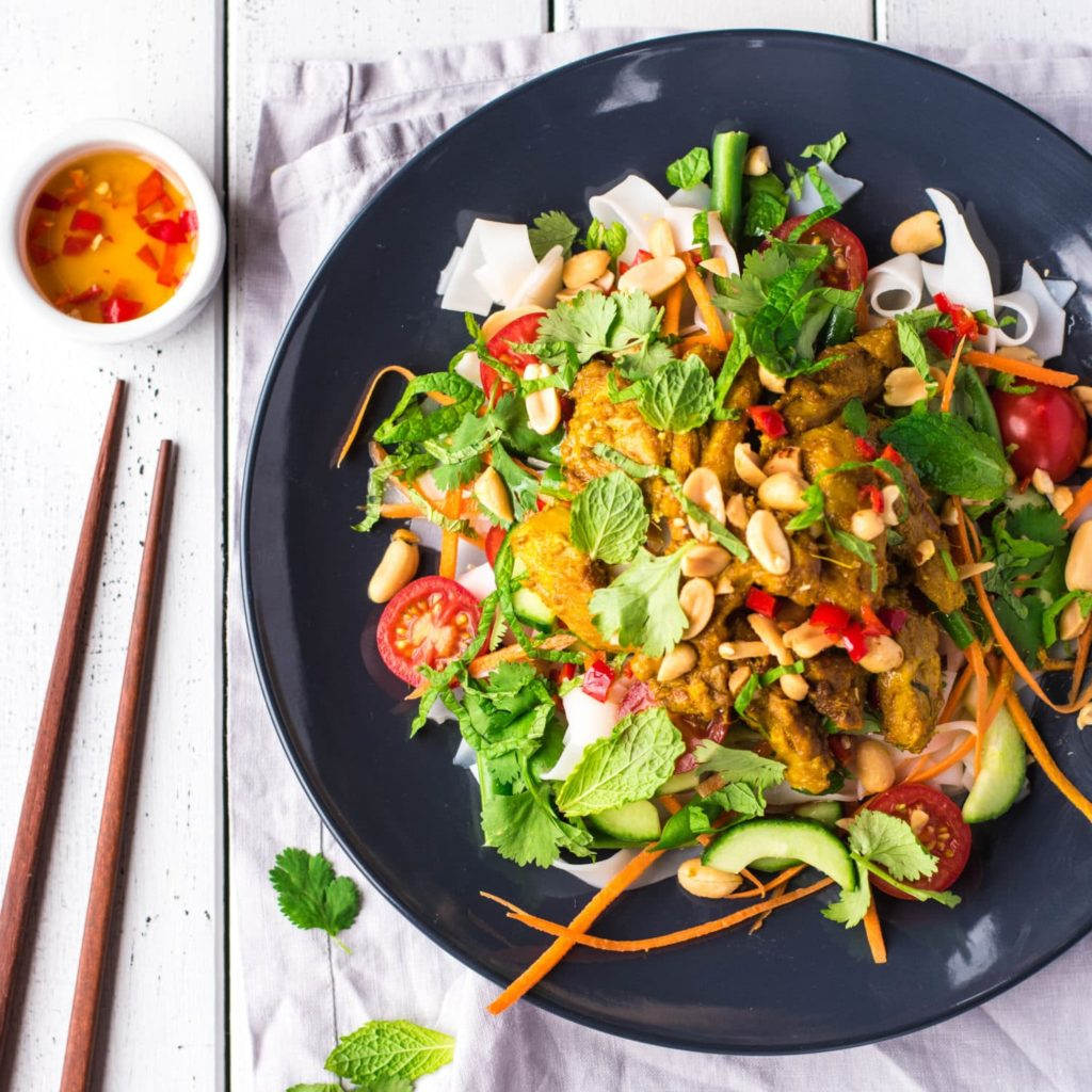 Rice noodle salad with chicken and vegetables