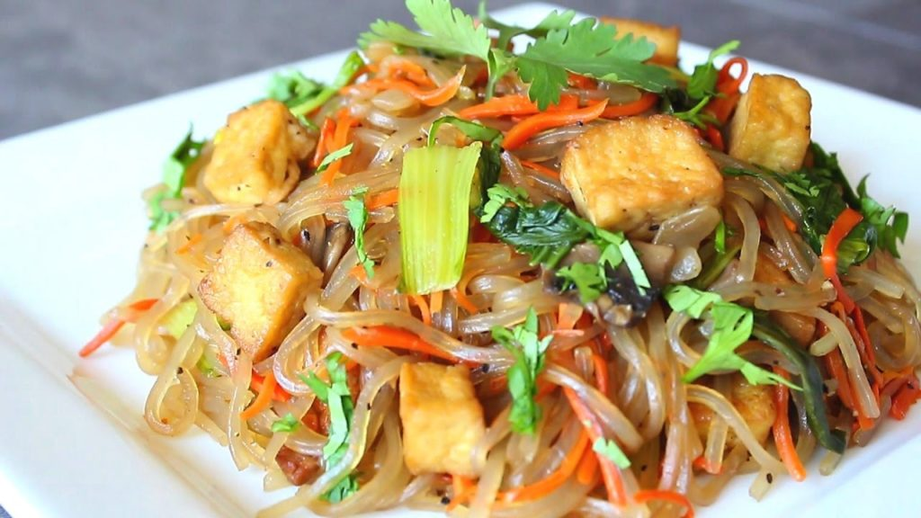 Rice noodles with vegetables in wok