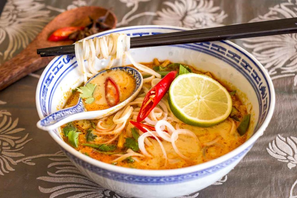 Soup with noodles and vegetables in Asian style