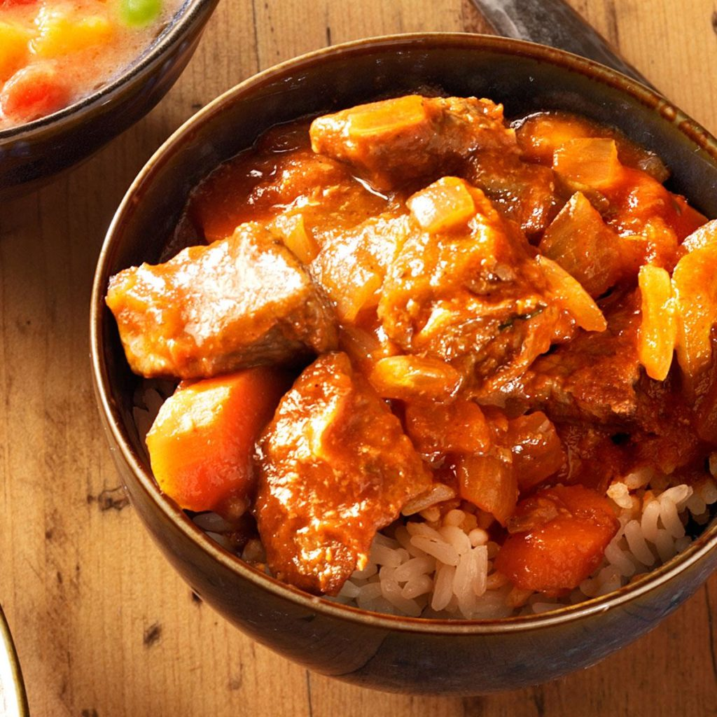 Beef in sweet and sour sauce with pumpkin and pineapple