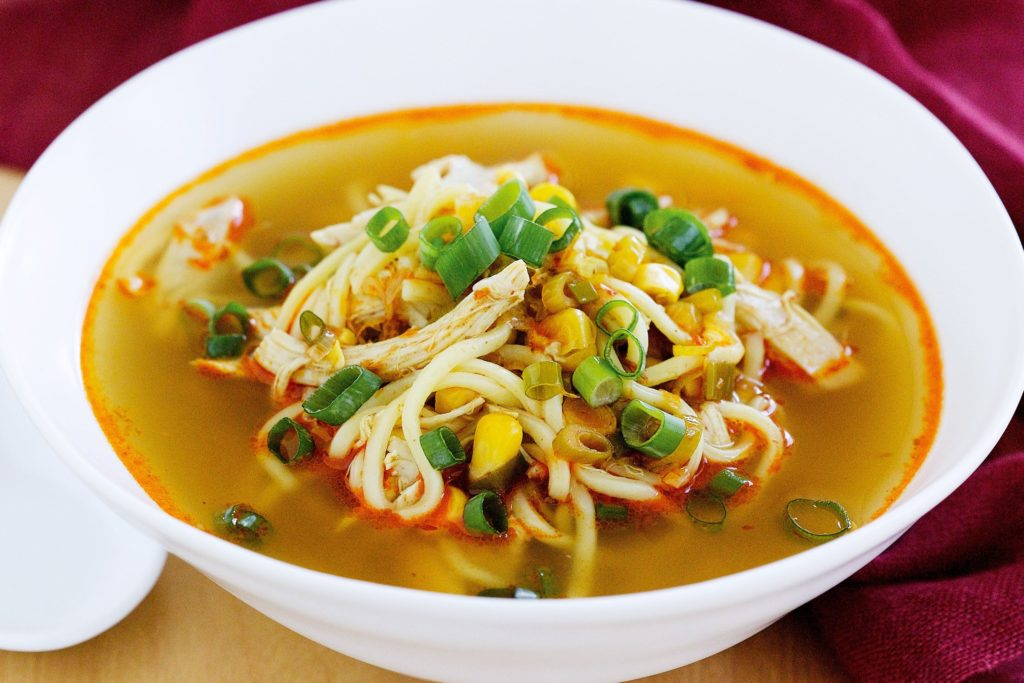 Chicken soup with noodles in Asian style