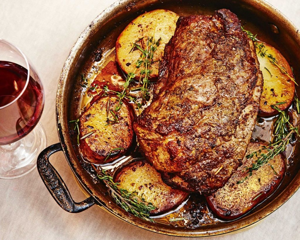 Pork with potatoes in the oven in French style