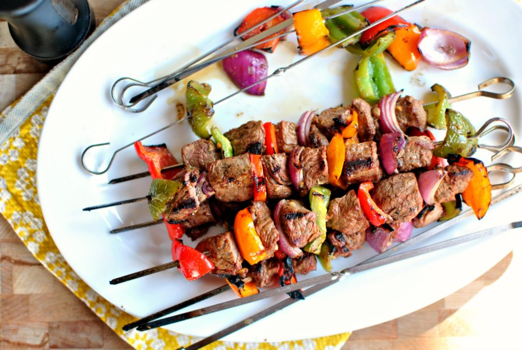 Shish kebabs of pork with onions and greens