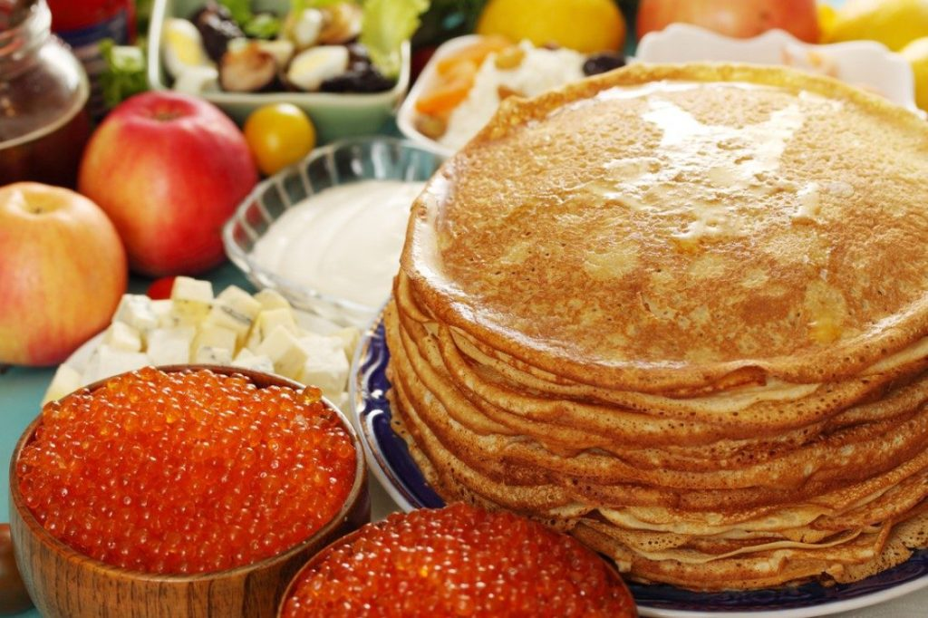 Pancakes on kefir with red fish