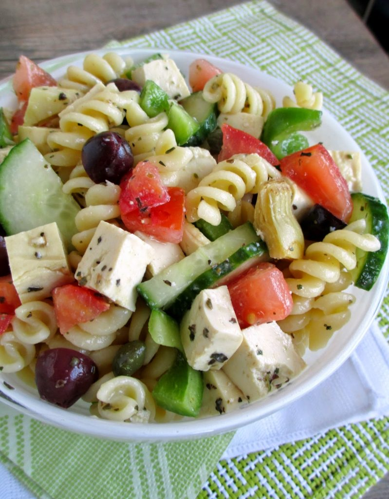 Greek salad with vegetables, cheese and pasta