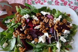 Tasty salad with cheese, beets and nuts